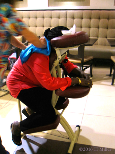 Hotel Hospitality Worker Receiving Chair Massage.
